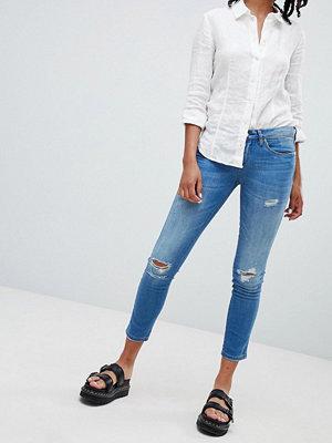 Blank NYC Smala jeans med slitna partier