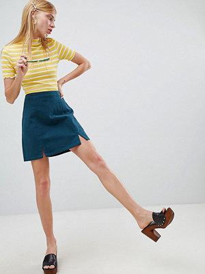 ASOS DESIGN denim split front mini skirt in emerald green
