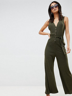 Asos Tall ASOS DESIGN Tall V neck jumpsuit with button front in slouchy rib - Khaki