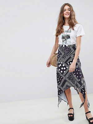 ASOS DESIGN spot and stripe midi skirt with hanky hem - Black/white