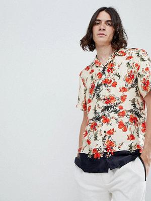 ASOS DESIGN regular fit floral shirt with border hem in satin