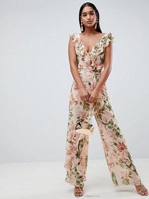 ASOS DESIGN Blommig jumpsuit i krinklat chifongtyg med volang