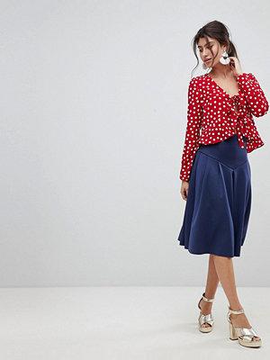 ASOS DESIGN seamed skater midi skirt with box pleats