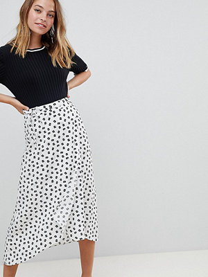 ASOS Petite ASOS DESIGN Petite wrap jacquard midi skirt in mixed floral and spot print - White