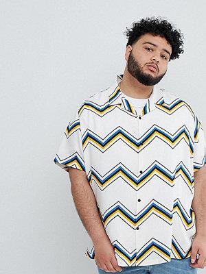 ASOS DESIGN Plus oversized chevron stripe shirt in ecru