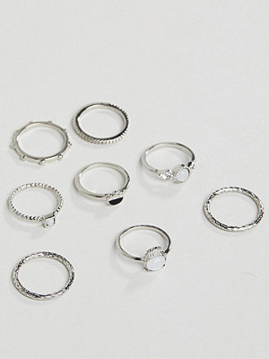 ASOS Curve ASOS DESIGN Curve pack of 8 rings with faux moonstone and engraved detail in silver - Rhodium