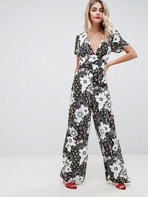 ASOS DESIGN Jumpsuit med blandade blommönster Blommigt mönster