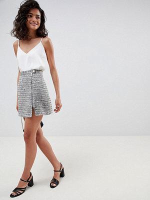 ASOS DESIGN boucle mini skirt with asymmetric zip