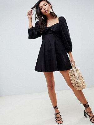 ASOS DESIGN sweetheart neck casual skater mini dress with bow detail