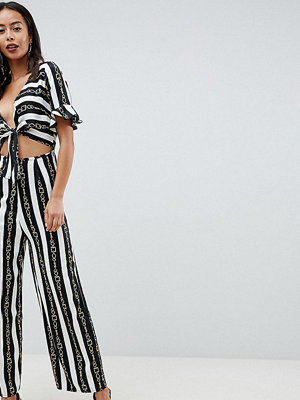 Asos Tall ASOS DESIGN tall tea jumpsuit with cut out and tie detail in chain print - Chain print