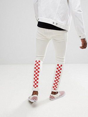ASOS DESIGN super skinny jeans in white with red checkerboard print - White