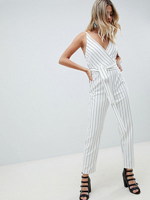 ASOS DESIGN wrap front jumpsuit with peg leg and self belt in stripe - Mono stripe