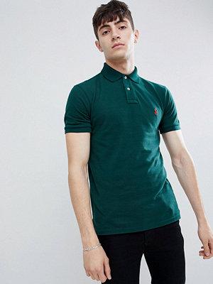 Polo Ralph Lauren slim fit pique polo player logo in dark green - College green