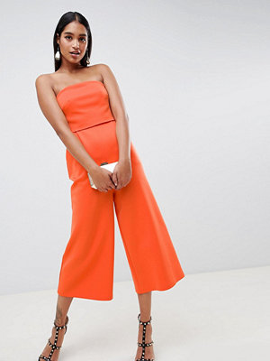ASOS DESIGN Bandeau-jumpsuit i scuba-tyg Orange som flammor