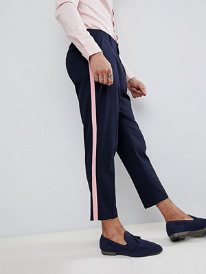 ASOS DESIGN tapered smart trousers in navy with pink frill side stripe