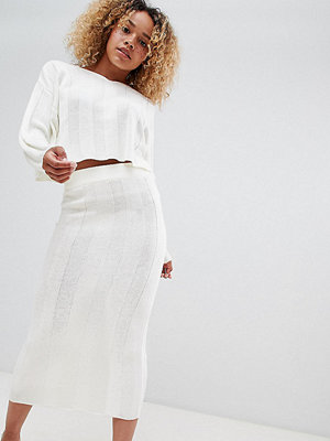 ASOS Petite ASOS DESIGN Petite co-ord midi skirt in wide rib