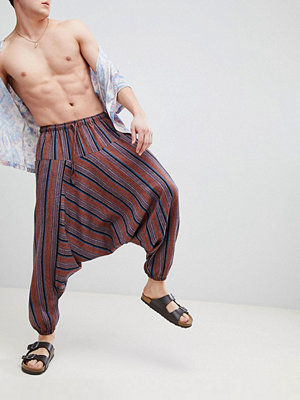 ASOS DESIGN festival extreme drop crotch joggers in stripe
