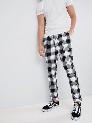 ASOS DESIGN tapered trousers in monochrome flannel check