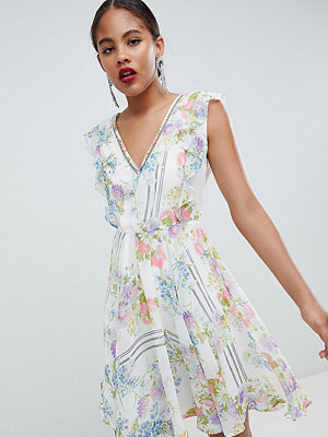 Asos Tall ASOS DESIGN Tall Ruffle Mini Dress With Open Back In Floral Print