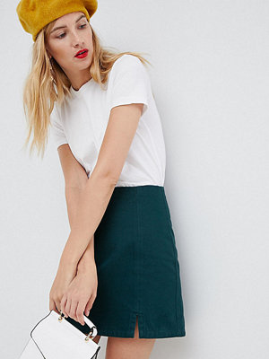 Asos Tall ASOS DESIGN Tall denim split front mini in emerald green