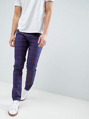 ASOS DESIGN skinny trousers in navy windowpane check