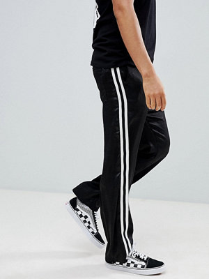 ASOS DESIGN straight trousers in black satin with white side tape