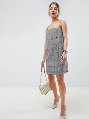 ASOS DESIGN square neck mini dress with buttons in check