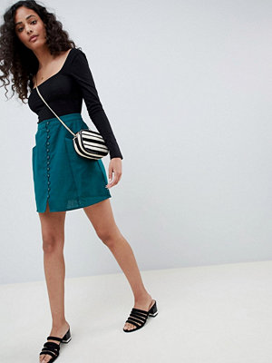 ASOS DESIGN linen mini skirt with button front - Green
