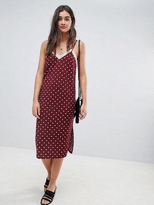ASOS DESIGN polka dot slip dress with lace insert - Spot print