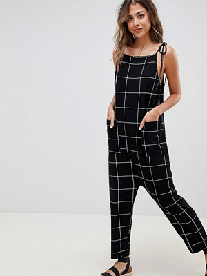 ASOS DESIGN jersey minimal jumpsuit with ties in check