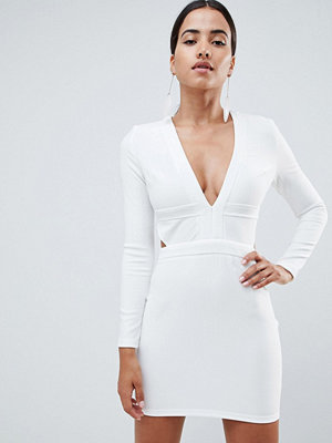 In The Style Tammy Hembrow ribbed plunge cut out mini dress