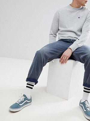 ASOS DESIGN skater jeans in smokey wash blue - Mid wash vintage