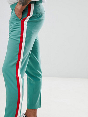 ASOS DESIGN skinny crop smart trousers in green with red & white side stripe