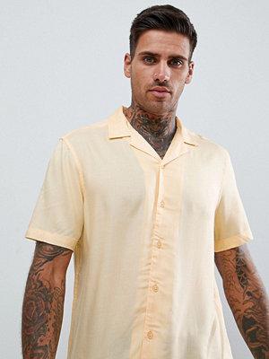 ASOS DESIGN regular fit viscose shirt with revere collar