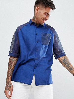 ASOS DESIGN oversized viscose shirt with mesh sleeves