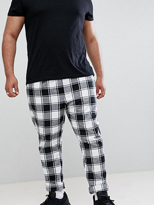 ASOS DESIGN Plus tapered trousers in monochrome flannel check