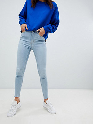 Weekday Body Superstretchiga skinny jeans med hög midja och råskuren kant Ljusblå