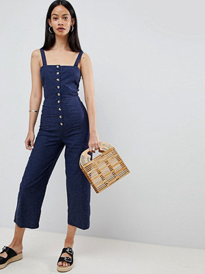 ASOS DESIGN textured denim button through jumpsuit - Midwash blue