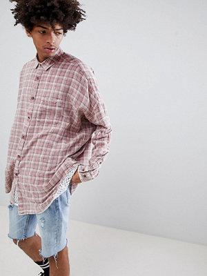 ASOS DESIGN oversized drop shoulder longline check shirt in bleach wash