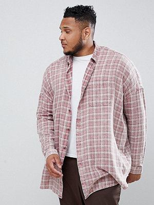 ASOS DESIGN Plus oversized drop shoulder check shirt with bleach wash in longline