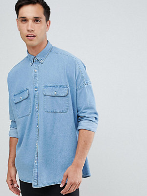 ASOS DESIGN Tall oversized denim shirt with double pockets