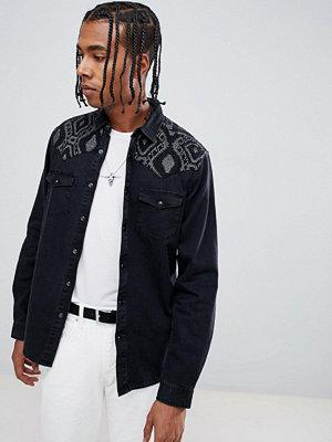 ASOS DESIGN regular fit western denim shirt with aztec print