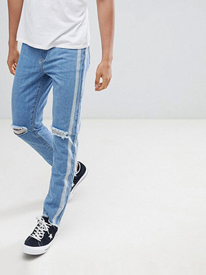 Jeans - boohooMAN slim jeans with side stripe in blue wash - Mid blue