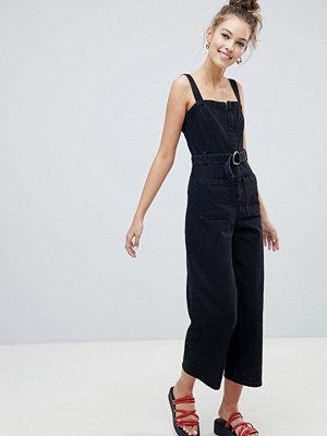 ASOS DESIGN denim jumpsuit with belt in washed black - Washed black