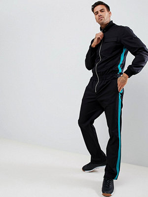 ASOS DESIGN slim fit flightsuit in black with green side tape