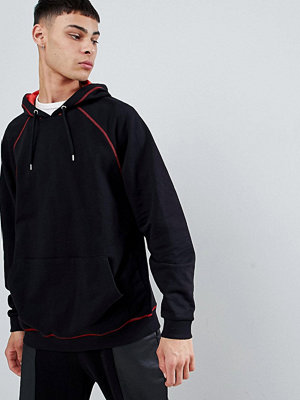 Street & luvtröjor - ASOS DESIGN oversized hoodie in red with contrast stitching - Black / crimson