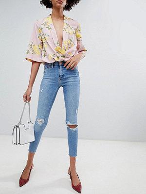 River Island Molly Slitna mellantvättade skinny jeans med rå kant Mid auth