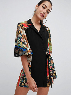 ASOS DESIGN playsuit with cape and scarf print detail