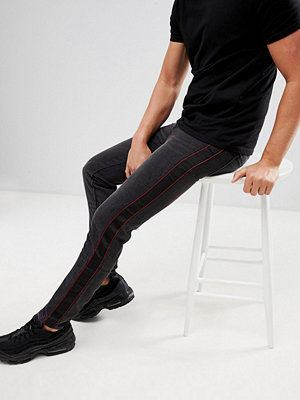 Jeans - boohooMAN skinny jeans with side stripe in black - Charcoal