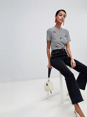 Warehouse Svarta beskurna jeans med utsvängda ben
